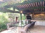 Outdoor dining for 12 equipped with a large brick bbq and sink