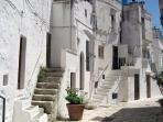 ancient village with a labyrinth of streets, alleys, stairs and houses glued together