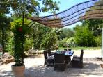 Eat and drink under the shaded 'pergola'outside the kitchen