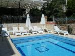 Outdoor swimming pool and sun loungers