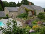 Swallows Cottage sits in five acres of gardens with orchards and river walks