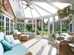 Sit back and relax in the comfy conservatory. Doors to patio area and garden and the kitchen too.