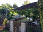 View from courtyard to covered garden terrace overlooking heated swimming pool