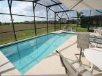 Pool overlooking open grassland