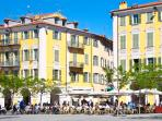 Enjoy the ambience of the cafes and restaurants in Place Garibaldi