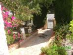 Garden entrance.Olive and almond trees with imaginative and colourful plants to welcome you