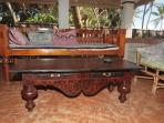 the teak day bed and coffee table on the veranda