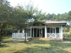 maison récente de charme en bois dans grand  jardin arboré à 5 mn à pied des plages