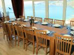 Dining room table with bay views seats 14
