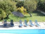 The sparkling pool, lawn & shady lemon trees viewed from upstairs balcony.