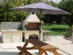 Informal outdoor dining area & Cypriot style BBQ, right next to the sparkling swimming pool.
