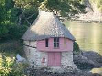 A quaint thatched boathouse on the River Avon