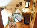 Single bed in twin bedroom of Threshing Barn