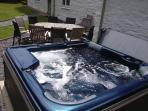Relax in the hot tub after a day out on the moors