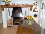 Dining room with wood burner