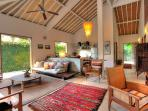 Antique furnishings in living area at Villa 007.