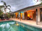 The swimming pool at sunset time is very beautiful at Villa 007.