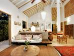 Colorful rugs and unique lighting add charm and character at Villa 007.