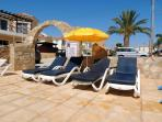 Your own exclusive sun loungers, thick mattresses and parasol at the poolside