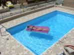 One of our guests making the most of the pool and the weather
