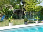 Slide, swings and trampoline