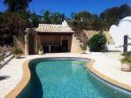 Pool with Jacuzzi / Bubbleseat and view on hot shower, kitchen & BBQ