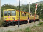 The scenic little yellow train stops several times a day at Osseja