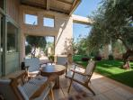 Veranda  Lounge area  Garden with flowers, lemon trees, olive grove and Artificial pond ...
