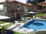Summer holiday. Outdoor shared pool and sun loungers