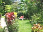 Relax in beautifully kept tropical gardens