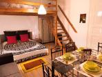 Room with wooden mezzanine platform