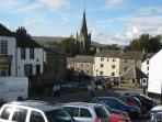 Alston Market Place with cream coloured Lantern House which has free unreserved parking nearby
