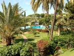 The wonderful view of the main pool and exotic gardens from our main terrace