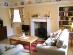 Living-room with its bespoke fireplace and wood-burning stove