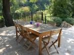 One of the outside dining areas with gas BBQ