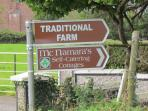 Signs to McNamaras Cottages &  Tradational Farm