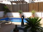Beautiful garden with water feature and private swimming pool, benefiting from all day sun.
