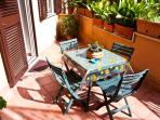 Private garden with dining set to enjoy a meal in a sunny day