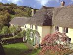 A beautiful thatched Devon longhouse with pool.