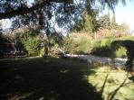 english style garden with the fountain (la fuenta name of villa}