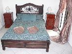 Main bedroom: double bed with bedside cabinets