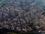 Cortona from the air. The ancient, the medieval and a small touch of the modern.