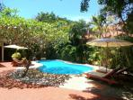 The Lovely Pool and Tropical Gardens Viewed from the Villa