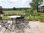 The garden terrace affords long views across the countryside