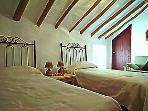 Original beams in bedrooms give lots of character