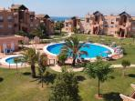 Superb luxury complex with 7 pools!   View from penthouse bedroom.