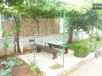 in the garden there is a table where you can enjoy the grape and fig tree shade. Here you can also B