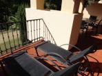 sun beds on sunny terrace
