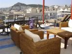 Enjoy an ouzo on the terrace overlooking the sites.