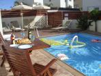 Lovely pool area - (shallow end .9m-deep 1.5 meter)  loungers , side tables.